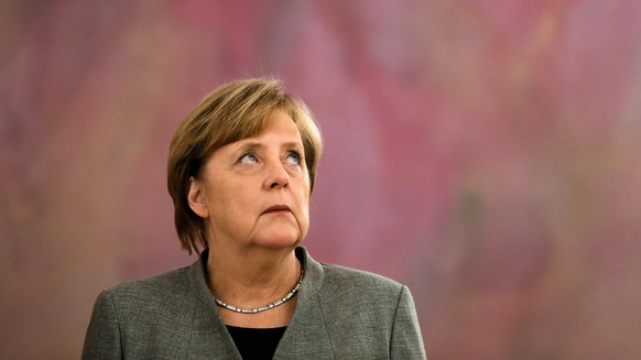 German Chancellor Angela Merkel attends the ceremony to receive her document of dismissal from President Frank-Walter Steinmeier in Berlin, Germany, Tuesday, Oct. 24, 2017. Following the Sept. 24, national election Angela Merkel will be managing chancellor until a new coalition takes over the government. (AP Photo/Markus Schreiber)