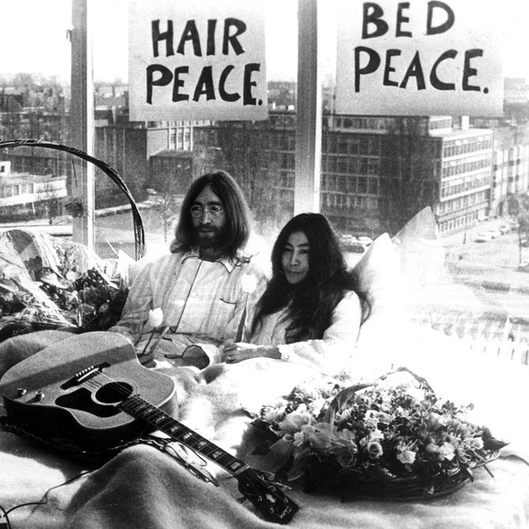 Mar 25, 1969 - Amsterdam, Netherlands - During the Vietnam War, in 1969, JOHN LENNON and YOKO ONO held two, week-long Bed-Ins for Peace, in Amsterdam and Montreal, which were their non-violent ways of protesting wars and promoting peace. Knowing their March 20, 1969 marriage would be a huge press event, John and Yoko decided to use the publicity to promote world peace. They spent their honeymoon in Room 702 at the Amsterdam Hilton Hotel for a week between March 25 and 31, inviting the world s press into their hotel room every day between 9 a.m. and 9 p.m. Amsterdam Netherlands PUBLICATIONxINxGERxONLY - ZUMAk09Mar 25 1969 Amsterdam Netherlands during The Vietnam was in 1969 John Lennon and Yoko Ono Hero Two Week Long Bed ins for Peace in Amsterdam and Montreal Which Were their Non Violent Ways of protesting Wars and Promoting Peace Knowing their March 20 1969 MARRIAGE Would Be a Huge Press Event John and Yoko decided to Use The Publicity to promote World Peace They spent their Honeymoon in Room 702 AT The Amsterdam Hilton Hotel for a Week between March 25 and 31 inviting The World S Press into their Hotel Room Every Day between 9 a M and 9 P M Amsterdam Netherlands PUBLICATIONxINxGERxONLY ZUMAk09