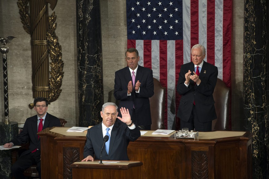 epa04646093 Israeli Prime Minister Benjamin Netanyahu (L) delivers a speech to a joint meeting of Congress on the floor of the US House of Representatives, in front of US House Speaker Republican John Boehner (C) and Republican Senator from Utah Orrin Hatch (R) in the US Capitol in Washington, DC, USA, 03 March 2015. Netanyahu opposes the Obama administrations ongoing negotiations with Tehran over Iran's nuclear ambitions.  EPA/SHAWN THEW  EPA/SHAWN THEW