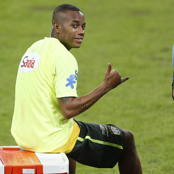 Brazil's Robinho sits on a cooler during a training session in Sao Paulo, Brazil, Saturday, June 6, 2015. Brazil will face Mexico on Sunday in a friendly soccer match in preparation for the Copa America in Chile which begins Thursday. (AP Photo/Andre Penner)