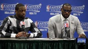 Miami Heat guard Dwyane Wade and forward LeBron James, right, talk with the media after Game 1 of the Eastern Conference finals NBA basketball playoff series against the Indiana Pacers, Sunday, May 18, 2014, in Indianapolis. The Pacers won 107-96. Wade scored 27 points and James had 25 for the two-time defending NBA champions, who lost for only the second time in 10 playoff games. (AP Photo/AJ Mast)