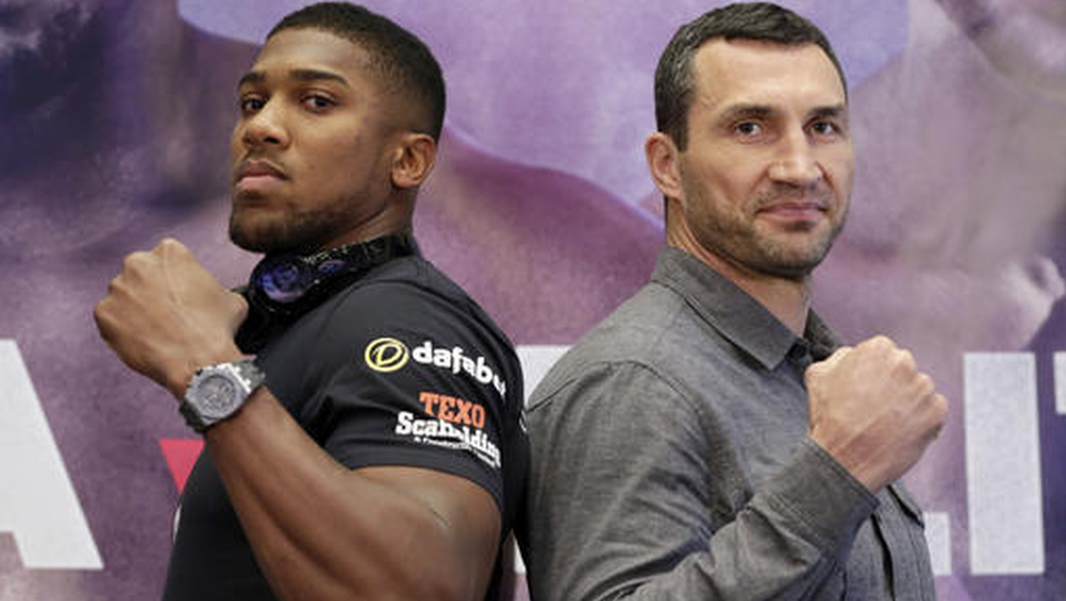 FILE - In this Jan. 31, 2017, file photo, IBF heavyweight champion Anthony Joshua, left, and former heavyweight champion Wladimir Klitschko pose for photos during a news conference at New York's Madison Square Garden. This week, British Olympic gold medalist Joshua meets  Klitschko in a title fight that figures to put a charge into a division that has been neglected for far too long. (AP Photo/Richard Drew, File)