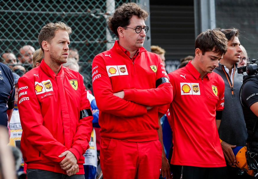 epa07809376 German Formula One driver Sebastian Vettel of Scuderia Ferrari (L), Ferrari team chief Mattia Binotto (C) and Monegasque Formula One driver Charles Leclerc of Scuderia Ferrari attend a minute of silence to pay tribute to Anthoine Hubert at the Spa-Francorchamps race track in Stavelot, Belgium, 01 September 2019. French driver Anthoine Hubert died after a high-speed collision on lap two of the Formula 2 race at the Belgian Grand Prix on 31 August.  EPA/STEPHANIE LECOCQ
