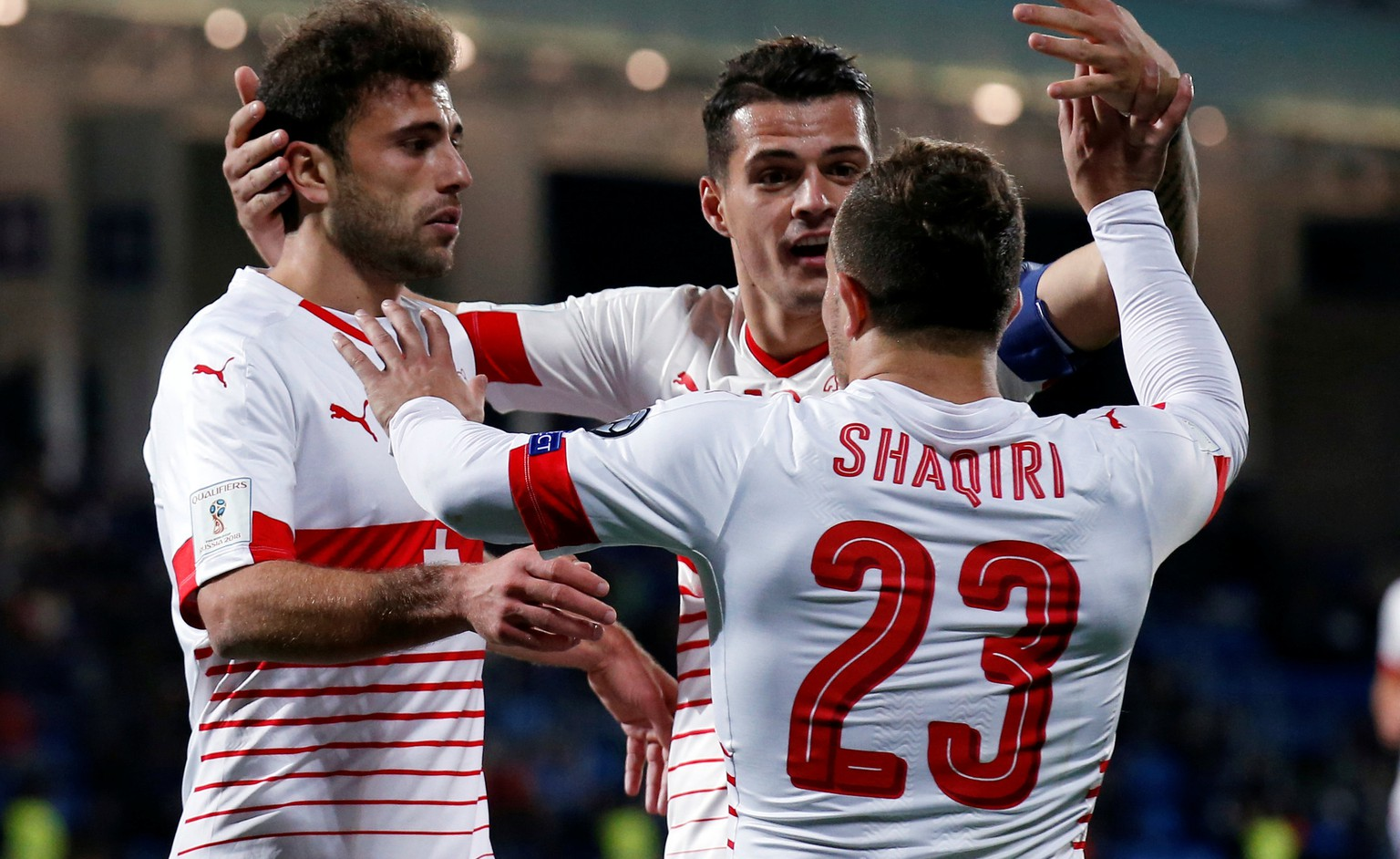 Football Soccer - Andorra v Switzerland - World Cup 2018 Qualifier - Estadi Nacional, Andorra la Vella, Andorra - 10/10/16.Switzerland's Xherdan Shaqiri, Admir Mehmedi and Granit Xhaka celebrate a goal. REUTERS/Albert Gea
