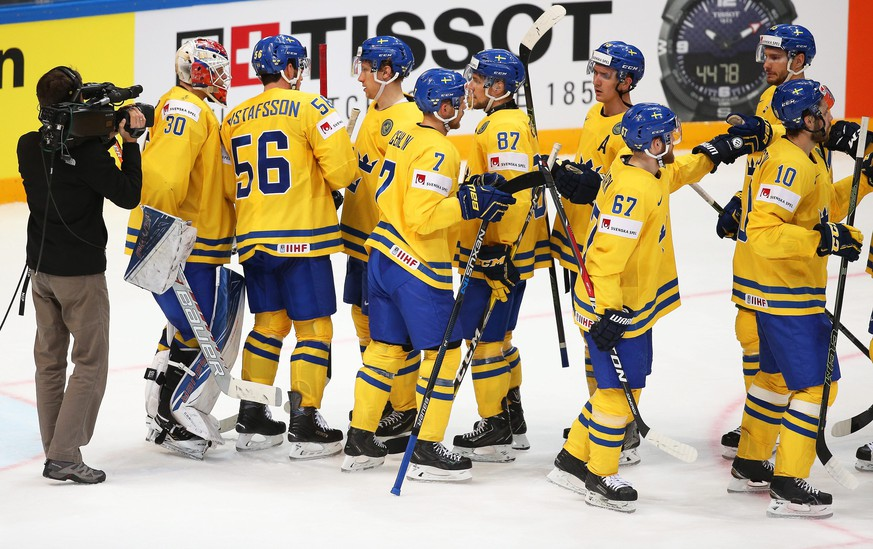 epa05300163 Swedish players celebrate after winning the Ice Hockey World Championship 2016 preliminary round match between Sweden and Kazakhstan at the Ice Palace in Moscow, Russia, 11 May 2016. Sweden won 7-3.  EPA/MAXIM SHIPENKOV