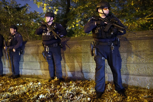 """Heavily armed New York City police officers stand guard across the street from the French consulate on New York's Fifth Ave., Friday, Nov. 13, 2015. Police in New York say they've deployed extra units to crowded areas of the city """"out of an abundance of caution"""" in the wake of the attacks in Paris, France. A New York Police Department statement released Friday stressed police have """"no indication that the attack has any nexus to New York City.""""(AP Photo/Mary Altaffer)"""