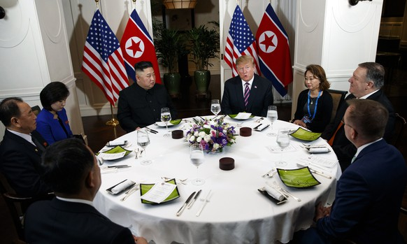President Donald Trump speaks during a dinner with North Korean leader Kim Jong Un, Wednesday, Feb. 27, 2019, in Hanoi. Seated on right are acting White House Chief of Staff Mick Mulvaney, Secretary of State Mike Pompeo and interpreter.  Seated on left are North Korean Vice Chairman Kim Yong Chol and North Korean Minister of Foreign Affairs, Ri Yong Ho and interpreter.  (AP Photo/ Evan Vucci)