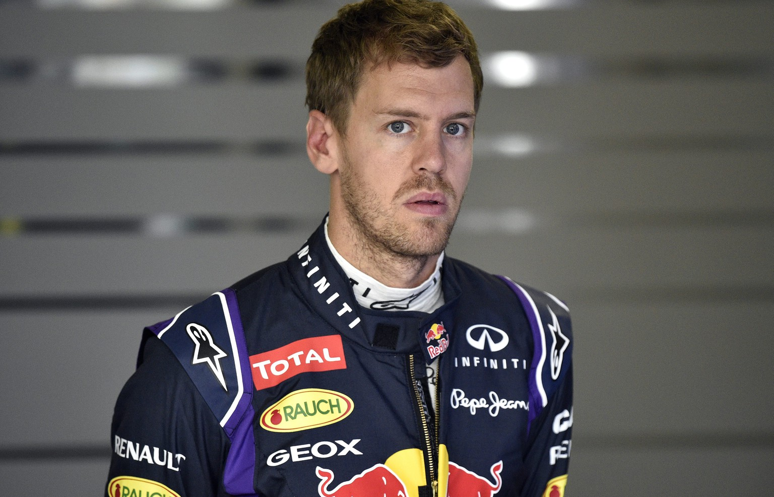 epa04430653 German Formula One driver Sebastian Vettel of Red Bull Racing looks on in the garage during the third practice session of the Japanese Formula One Grand Prix at the Suzuka Circuit in Suzuka, Mie Prefecture, central Japan, 04 October 2014. The Japanese Formula One Grand Prix will be held on 05 October 2014. According to his team, Sebastian Vettel will leave Infiniti Red Bull Racing at the end of this season.  EPA/FRANCK ROBICHON