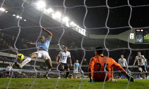 Manchester City's Vincent Kompany, left, scores his side's fifth goal during the English Premier League soccer match between Tottenham Hotspur and Manchester City at White Hart Lane stadium in London, Wednesday, Jan. 29, 2014.  (AP Photo/Matt Dunham)