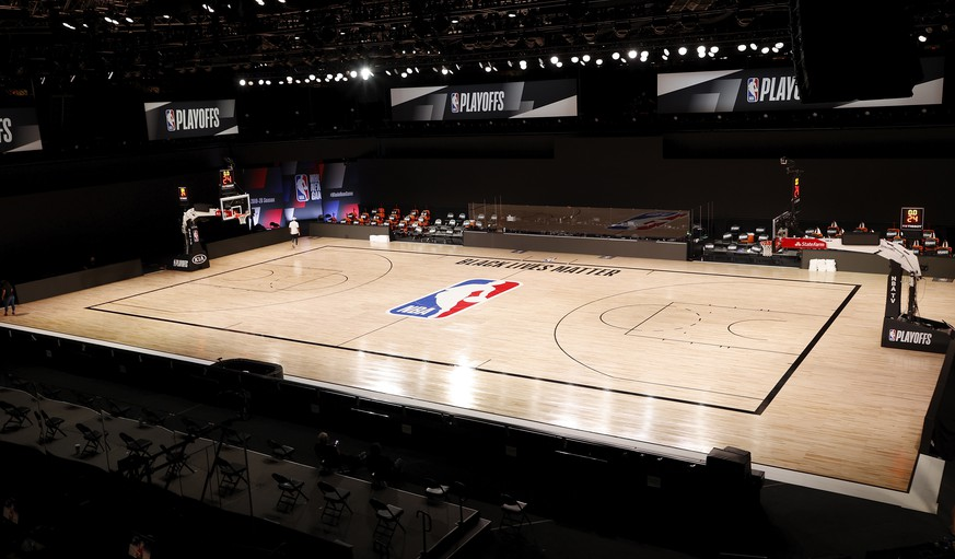 epa08627753 The court remains empty inside the AdventHealth Arena at the ESPN Wide World of Sports Complex in Kissimmee, Florida, USA, 26 August 2020. According to media reports the Milwaukee Bucks did not take the court for game five against the Orlando Magic, in a protest of the police shooting of 29 year old Jacob Blake, a Black man from Kenosha, Wisconsin, on 23 August 2020. The NBA has postponed all three games that were to take place 26 August 2020.  EPA/JOHN G. MABANGLO  SHUTTERSTOCK OUT