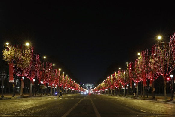 The Champs Elysees avenue with the Arc de Triomphe is illuminated as part of Christmas lightings, In Paris, Wednesday, Nov. 25, 2020. (AP Photo/Francois Mori)