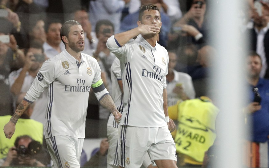 Real Madrid's Cristiano Ronaldo, right, celebrates after scoring his side's first goal during the Champions League quarterfinal second leg soccer match between Real Madrid and Bayern Munich at Santiago Bernabeu stadium in Madrid, Spain, Tuesday April 18, 2017. (AP Photo/Daniel Ochoa de Olza)