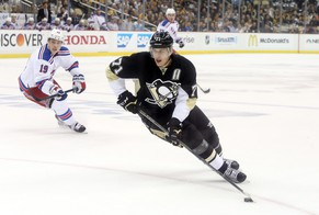 Apr 20, 2015; Pittsburgh, PA, USA; Pittsburgh Penguins center Evgeni Malkin (71) skates with the puck against the New York Rangers during the first period in game three of the first round of the 2015 Stanley Cup Playoffs at the CONSOL Energy Center.  The Rangers won 2-1. Mandatory Credit: Charles LeClaire-USA TODAY Sports