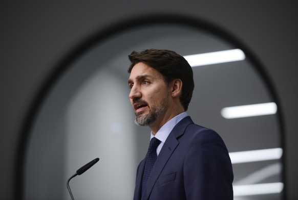 Canada Prime Minister Justin Trudeau speaks on the first day of the Munich Security Conference in Munich, Germany, Friday, Feb. 14, 2020.  (Sean Kilpatrick/The Canadian Press via AP)