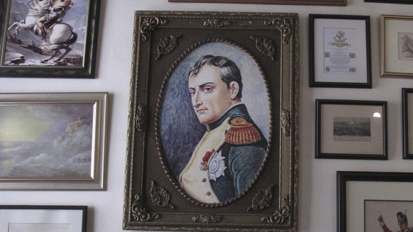 In this Oct. 15, 2017, photo, several images of Napoleon Bonaparte are shown in this collection of framed pictures on a wall in the Consulate hotel in Jamestown on St. Helena island in the Atlantic Ocean. Napoleon was sent into exile there in 1815 and died on the island in 1821; the relatively few tourists who make it to remote St. Helena are likely to visit Longwood House, where the deposed French emperor died after an illness. (AP photo/Christopher Torchia)