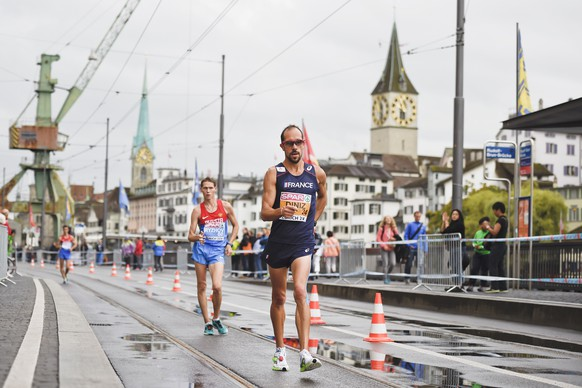 Yohann Diniz of France (R) and Mikhail Ryzhoh of Russia (L) compete in the men's 50km walk during the European Athletics Championships in Zurich on August 15, 2014, Diniz broke the world 50km walk record at the European Athletics Championships on Friday in a time of 3hr 32min 33sec. AFP PHOTO / MICHAEL BUHOLZER