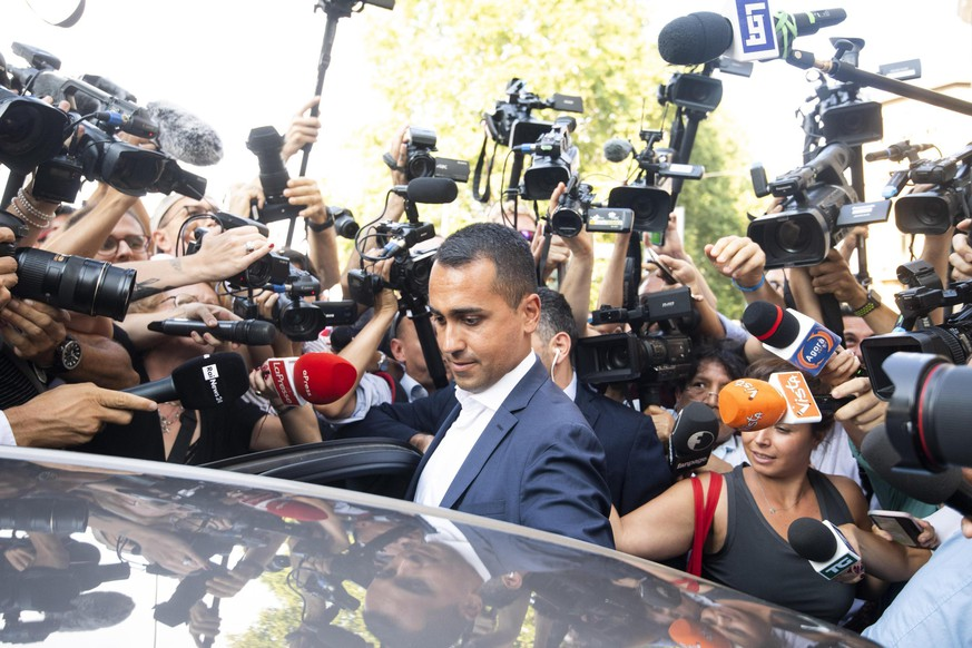 The political leader of the 5-Stars Movement, Italian Deputy Premier and Labor Minister, Luigi Di Maio, gets into his car at the end of the meeting with the staff of his party, in Rome, Monday, Aug. 26, 2019. The 5-Stars and the opposition center-left Democrats were scrambling in closed-door discussions to see if they can cobble together a coalition, despite sharp differences on who would be premier. (Angelo Carboni/ANSA via AP)