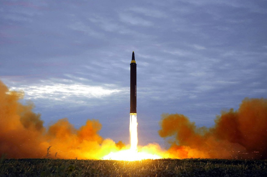 FILE - This Aug. 29, 2017, file photo by the North Korean government shows what was said to be the test launch of a Hwasong-12 intermediate range missile in Pyongyang, North Korea. Three weeks after the U.S.-North Korea summit and ahead of an impending trip to North Korea by U.S. Secretary of State Mike Pompeo, a leaked U.S. intelligence report and an analysis of satellite data suggest the North may be continuing its nuclear and missile activities despite a pledge to denuclearize. (Korean Central News Agency/Korea News Service via AP, File)
