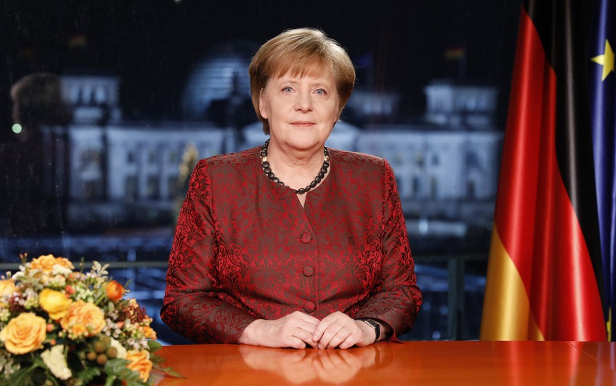 epa06410846 German Chancellor Angela Merkel records her annual, televised new year's address in Berlin, Germany 20 December 2017, (issued 31 December 2017). Merkel is entering 2018 still seeking a new government following elections in September, 2017. Her party, the German Christian Democrats (CDU), together with the CSU of Bavaria, are in talks with the German Social Democrats (SPD), though the outcome remains so far uncertain.  EPA/Michele Tantussi / POOL (EDITOR'S NOTE: Publication embargoed until 0:00 on December 31, 2017)