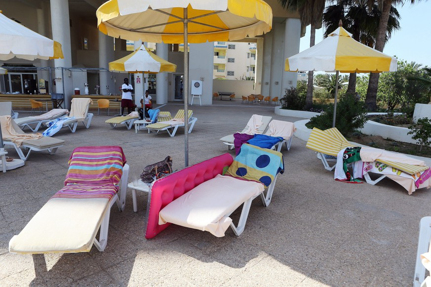 epa04820231 Deck chairs with towels lie abandoned at the Imperial Marhaba Hotel in the resort town of al-Sousse, a popular tourist destination 140 km south of Tunis,Tunisia, June 26 June 2015. According to local reports unknown assailants detonated at least one bomb then opened fire on tourists at two hotels, killing at least 28, including Germans, Brits and Belgians and wounding several others, some while they were sunbathing, at least one of the attackers was killed by Tunisian security services, while a second has been arrested.  EPA/MOHAMED MESSARA