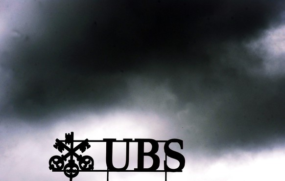 epa04334764 (FILE) A file photograph dated 14 July 2011 shows dark clouds above the UBS logo on the bank's head office in Zurich, Switzerland. UBS has settled a major tax evasion case in Germany and has agreed to pay a penalty of 300 million euros (403 million dollars), Switzerland's biggest bank said 29 July 2014 in Zurich. Prosecutors in Bochum in the German state of North Rhine-Westphalia had launched investigations against UBS on suspicion that it had helped German clients hide taxable income in foundations in about 750 cases. 'Tax evasion does not have a future as a business model,' North Rhine-Westphalia's Justice Minister Thomas Kutschaty said. Provisions for the penalty put a burden on earnings in the second quarter. Operating profits at the bank's wealth management arm dropped 43 per cent to 355 million Swiss francs (392 million dollars), compared to the same period last year.  EPA/WALTER BIERI *** Local Caption *** 50577060