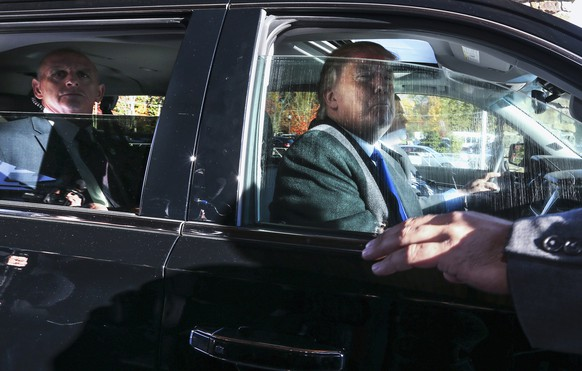 Republican presidential candidate Donald Trump looks out from his car window as he leaves after speaking at a town hall meeting at the Atkinson Country Club in Atkinson, N.H., Monday, Oct. 26, 2015.  (AP Photo/Cheryl Senter)