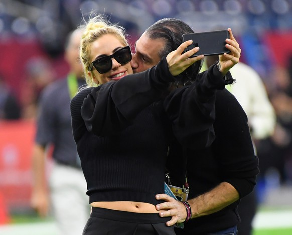 Feb 5, 2017; Houston, TX, USA; Recording artist Lady Gaga gets a kiss from Christian Carino before Super Bowl LI between the Atlanta Falcons and the New England Patriots at NRG Stadium. Mandatory Credit: Robert Deutsch-USA TODAY Sports
