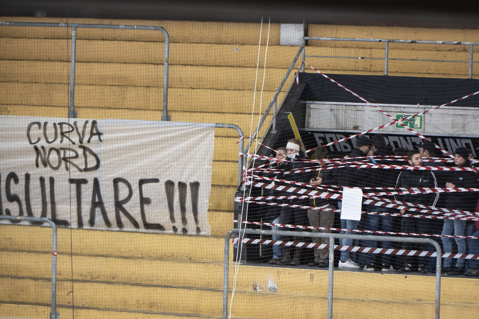A banner is displayed on the stand of the Lugano fans, during the preliminary round game of National League A (NLA) Swiss Championship between HC Lugano and EHC Bienne at the ice stadium Corner Arena in Lugano, on Friday, December 20, 2019. (KEYSTONE/Ti-Press/Pablo Gianinazzi)
