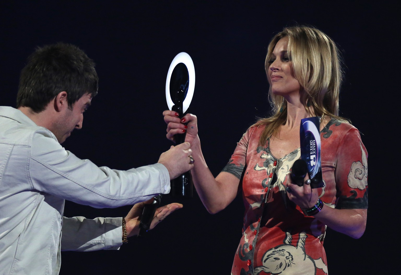 Kate Moss is seen on stage accepting the award for British Male Solo Artist on behalf of winner David Bowie from Noel Gallagher at the BRIT Awards 2014 at the O2 Arena in London on Wednesday, Feb. 19, 2014. (Photo by Joel Ryan/Invision/AP)