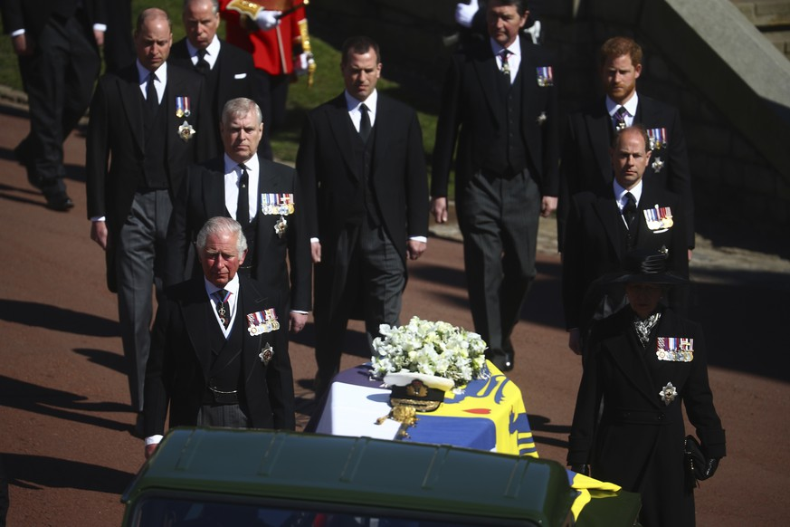 Members of the Royal family follow the coffin of Britain's Prince Philip during his funeral inside Windsor Castle in Windsor, England, Saturday, April 17, 2021. Prince Philip died April 9 at the age of 99 after 73 years of marriage to Britain's Queen Elizabeth II. (Hannah McKay/Pool via AP)