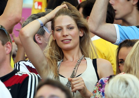 epa04299100 Sarah Brandner, girlfriend of Germany's Bastian Schweinsteiger, on the stands during the FIFA World Cup 2014 quarter final match between France and Germany at the Estadio do Maracana in Rio de Janeiro, Brazil, 04 July 2014.   (RESTRICTIONS APPLY: Editorial Use Only, not used in association with any commercial entity - Images must not be used in any form of alert service or push service of any kind including via mobile alert services, downloads to mobile devices or MMS messaging - Images must appear as still images and must not emulate match action video footage - No alteration is made to, and no text or image is superimposed over, any published image which: (a) intentionally obscures or removes a sponsor identification image; or (b) adds or overlays the commercial identification of any third party which is not officially associated with the FIFA World Cup)  EPA/OLIVER WEIKEN   EDITORIAL USE ONLY