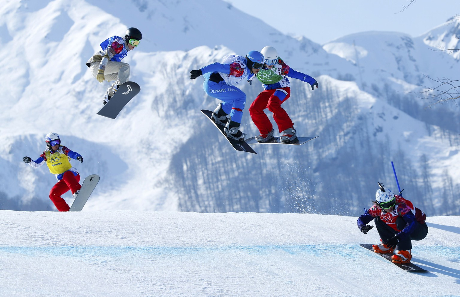 France's Deborah Anthonioz, Faye Gulini of the U.S., Austria's Maria Ramberger, France's Nelly Moenne Loccoz and Eva Samkova (L-R) of the Czech Republic compete during the women's snowboard cross semi-finals at the 2014 Sochi Winter Olympic Games in Rosa Khutor February 16, 2014.               REUTERS/Mike Blake (RUSSIA  - Tags: OLYMPICS SPORT SNOWBOARDING)