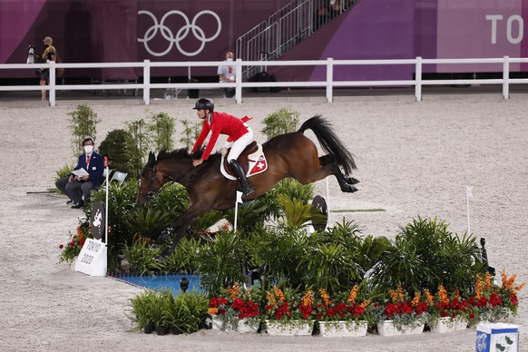 Steve Guerdat of Switzerland riding Venard de Cerisy competes in the equestrian jumping individual qualifier at the 2020 Tokyo Summer Olympics in Tokyo, Japan, on Tuesday, August 03, 2021. (KEYSTONE/Peter Klaunzer)
