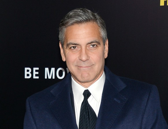 FILE - In this Feb. 4, 2014 file, director and actor George Clooney attends the premiere of