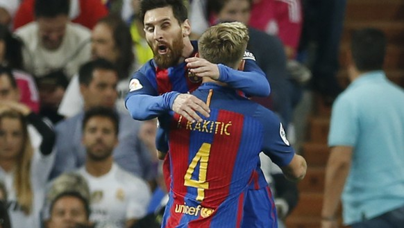 Barcelona's Ivan Rakitic, right, celebrates with his teammate Lionel Messi, after scoring during a Spanish La Liga soccer match between Real Madrid and Barcelona, dubbed 'el clasico', at the Santiago Bernabeu stadium in Madrid, Spain, Sunday, April 23, 2017. (AP Photo/Francisco Seco)