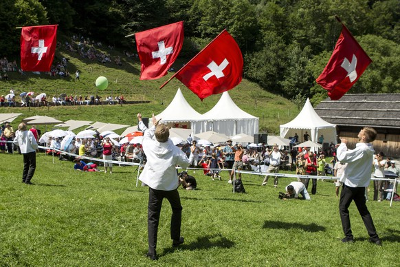 epa06119833 A group of flag-swingers with Swiss flags at the Ruetli meadow above the Lake Lucerne, Switzerland, 01 August 2017. Switzerland celebrates the National Day on 01 August.  EPA/ALEXANDRA WEY