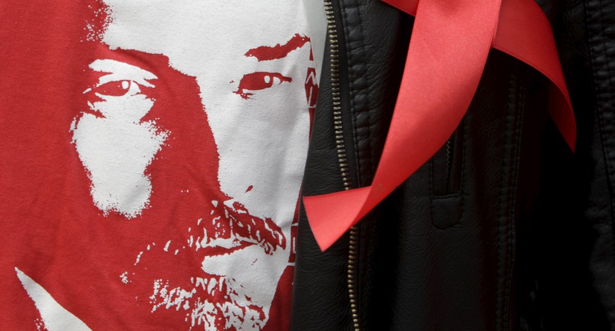 A supporter of Russia's Communist party wears a t-shirt with an image of Soviet state founder Vladimir Lenin during a May Day rally in central Stavropol May 1, 2015. International Workers' Day, also known as Labour Day or May Day, commemorates the struggle of workers in industrialised countries in the 19th century for better working conditions.  REUTERS/Eduard Korniyenko