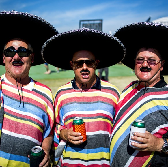 epa04661418 Formula One fans dressed in Mexican ponchos and sombreros pose for a photo before the third practice session at the Albert Park circuit for the Australian Formula One Grand Prix in Melbourne, Australia, 14 March 2015. The 2015 Formula One Grand Prix of Australia will take place on 15 March.  EPA/DIEGO AZUBEL