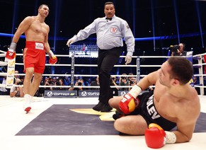 Bulgarian boxer Kubrat Pulev, right, and IBF, WBA, WBO and IBO champion Wladimir Klitschko from Ukraine, punch during their IBF heavy-weight world championships title bout in Hamburg, Germany, Saturday, Nov. 15,  2014.(AP Photo/Frank Augstein)