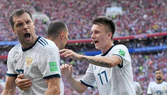 epa06855124 Artem Dzyuba (L) of Russia celebrates scoring the equalizer from the penalty spot during the FIFA World Cup 2018 round of 16 soccer match between Spain and Russia in Moscow, Russia, 01 July 2018.  (RESTRICTIONS APPLY: Editorial Use Only, not used in association with any commercial entity - Images must not be used in any form of alert service or push service of any kind including via mobile alert services, downloads to mobile devices or MMS messaging - Images must appear as still images and must not emulate match action video footage - No alteration is made to, and no text or image is superimposed over, any published image which: (a) intentionally obscures or removes a sponsor identification image; or (b) adds or overlays the commercial identification of any third party which is not officially associated with the FIFA World Cup)  EPA/FACUNDO ARRIZABALAGA   EDITORIAL USE ONLY