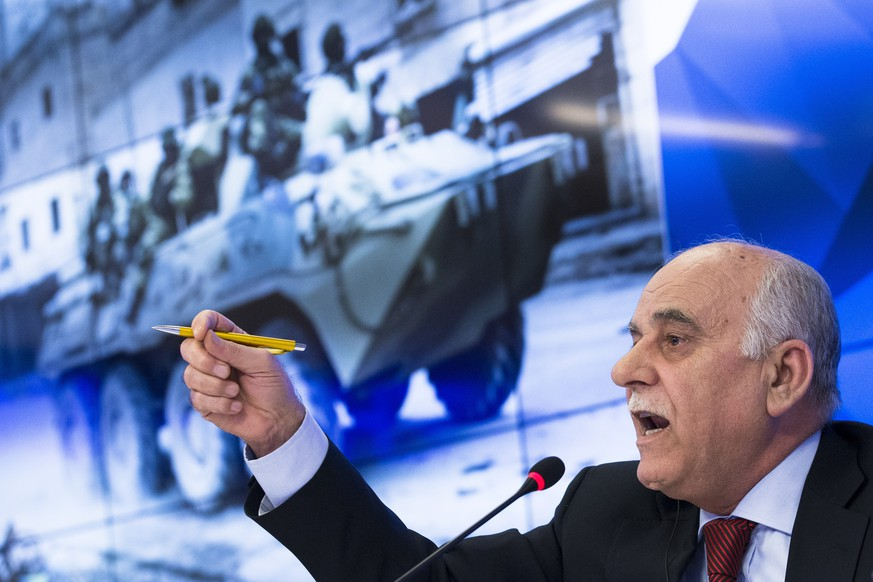 General Mustafa Al-Sheikh, former head of the Free Syrian Army and the head of a Syrian opposition delegation visiting Moscow, gestures while speaking to the media in Moscow, Russia, Friday, Jan. 13, 2017. Al-Sheikh commented on the planned Syria peace conference in Astana, saying its main goal is to secure a lasting cease-fire in Syria and prepare talks in Geneva on Syria political settlement. (AP Photo/Ivan Sekretarev)