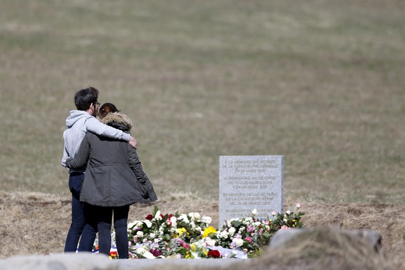 epa04686678 Relatives of the victims of the air crash visit the memorial in Le Vernet, south-eastern, France, 30 March 2015. Germanwings Flight 4U 9525, carrying 144 passengers and six crew members from Barcelona, Spain, to Dusseldorf, Germany, crashed 24 March in the French Alps, where searchers combed a 4-hectare section of mountain face since 25 March. The co-pilot deliberately crashed the aircraft, French officials said on 26 March.  EPA/YOAN VALAT ATTENTION EDITORS