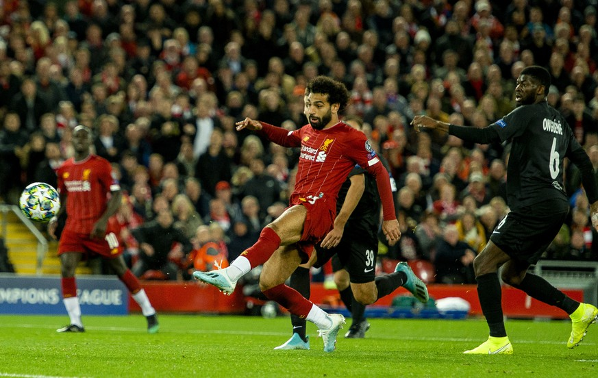 epa07890501 Liverpool's Mohamed Salah (C) scores the 4-3 goal during the UEFA Champions League Group E soccer match between Liverpool FC and FC Salzburg held at the Anfield in Liverpool, Britain, 02 October 2019.  EPA/PETER POWELL .