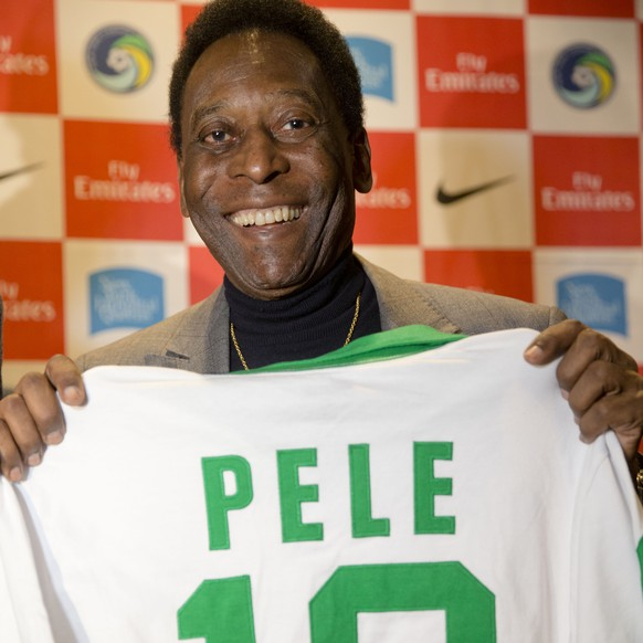 Edson Arantes do Nascimento, better known as Pele, poses for photographs during a question-and-answer session at the National Soccer Coaches Association of America convention, Thursday, Jan. 15, 2015, in Philadelphia. (AP Photo/Matt Rourke)