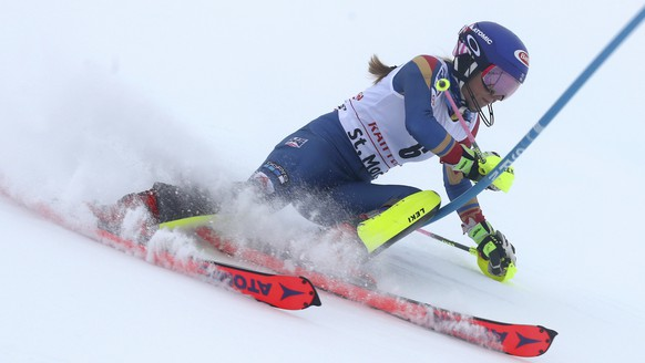 United States' Mikaela Shiffrin speeds down the course during the slalom portion of an alpine ski, women's World Cup combined, in St. Moritz, Switzerland, Friday, Dec. 8, 2017. (AP Photo/Marco Trovati)