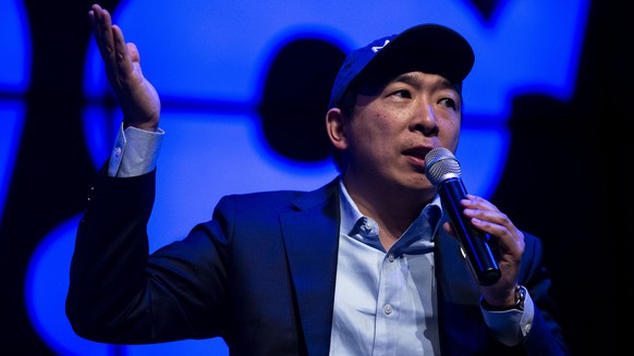 Democratic presidential candidate Andrew Yang speaks and answers questions from the audience during a town hall, Sunday, April 28, 2019, at Franklin Junior High in Des Moines, Iowa. (Kelsey Kremer/The Des Moines Register via AP)