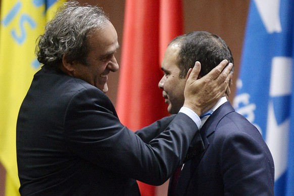 epa04774648 Prince Prinz Ali bin al-Hussein (R) with UEFA President Michel Platini (L) after announcing his withdrawal during the 65th FIFA Congress at the Hallenstadion in Zurich, Switzerland, 29 May 2015. FIFA President Joseph S. Blatter has been re-elected as FIFA president for a fifth term, chosen to lead world soccer despite separate U.S. and Swiss criminal investigations into corruption. The 209 FIFA member federations gave the 79-year-old Blatter another four-year term on Friday after Prince Ali bin al-Hussein of Jordan conceded defeat after losing 133-73 in the first round.  EPA/WALTER BIERI