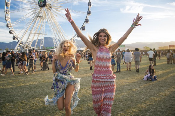 Festival goers Joy Corrigan, left, and Ashley Haas dance at Coachella Music & Arts Festival at the Empire Polo Club on Sunday, April 16, 2017, in Indio, Calif. (Photo by Amy Harris/Invision/AP)