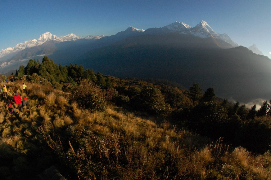 FILE - In this Friday, Oct. 24, 2014 file photo, trekkers watch the sun rise over the Annapurna Range, right, in central Nepal, as viewed from Poon Hill, above the village of Ghorepani. A Finnish climber and his local guide died Wednesday, March 25, 2015, while descending from the summit of Mount Annapurna in the first casualties of this mountaineering season, a Nepal mountaineering official said. Annapurna is the world's 10th highest mountain and among the most dangerous to climb. (AP Photo/Malcolm Foster, File)