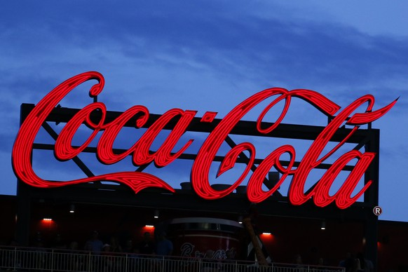 FILE - In this July 20, 2019, file photo a Coca-Cola billboard is shown over left field at SunTrust Park during a baseball game between the Washington Nationals and Atlanta Braves in Atlanta. The Coca-Cola Co. reports financial results on Thursday, Jan. 30, 2020. (AP Photo/John Bazemore, File)